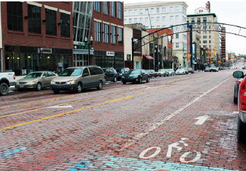 Road Diet in Flint, Michigan, central business district features a dedicated bike lane and on-street parking.
